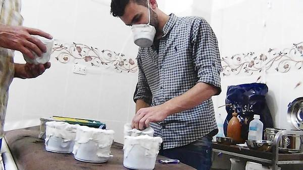 Activists and medics manufacture homemade chemical masks in the Damascus suburb of Zamalka.