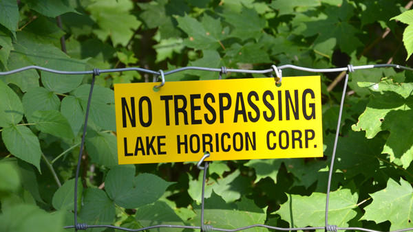 Left: A fence surrounds all of Lake Horicon Corp.s property except the area of Charles Sanders Road, a two-mile seasonal roadway which runs through the wooded area. If abandoned by the Otsego County Road Commission, the countys 66-foot right-of-way would revert to Lake Horicon Corp. and one other landowner.