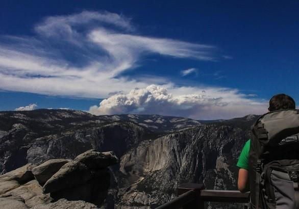Smoke from the Rim fire is visible off in the distance from Yosemite Valley's Glacier Point.