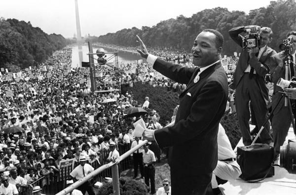 "This August 28, 1963 file photo shows US civil rights leader Martin Luther King (C) waving from the steps of the Lincoln Memorial to supporters on the Mall in Washington, DC, during the ""March on Washington"". US President Barack Obama will mark the 50th anniversary of Martin Luther King's ""I have a dream"" speech by speaking from the same steps at the Lincoln Memorial in Washington. The August 28 event in the US capital will take place on the exact spot where King delivered his famous address on the same day in 1963. Obama, the first black US president, will speak about the half century that has passed since the ""March on Washington for Jobs and Freedom,"" which culminated with remarks by the Atlanta pastor and civil rights icon. In 1963 King spoke in front of 250,000 people, explainin"