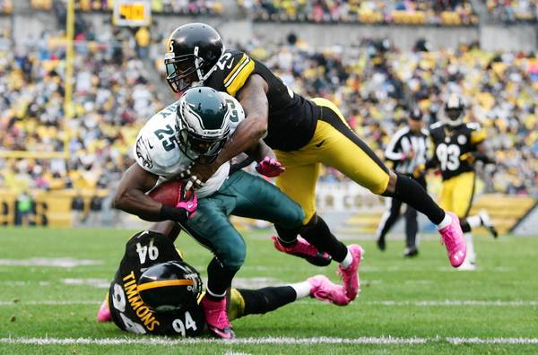 October 7, 2012; Pittsburgh, PA, USA; Philadelphia Eagles running back LeSean McCoy (25) scores on a fifteen yard touchdown pass against Pittsburgh Steelers inside linebacker Lawrence Timmons (94) and free safety Ryan Clark (25) during the third quarter at Heinz Field.