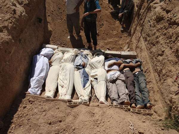 An image provided by the Shaam News Network on Aug. 22, 2013, was said to show bodies being buried in a suburb of Damascus after an alleged chemical attack.