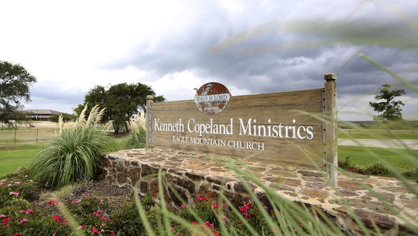 A sign marks the entrance of the Kenneth Copeland Ministries Eagle Mountain Church, which is linked to at least 21 cases of measles and has been trying to contain the outbreak by hosting vaccination clinics, officials said.