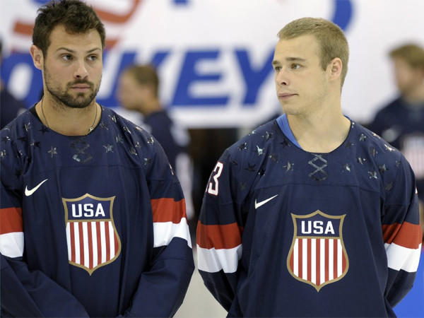 Members of the 2013 USA Hockey Men's National Team, Zach Bogosian, left, of the Winnipeg Jets, and Dustin Brown, Kings, wear the newly unveiled team jersey on Tuesday.