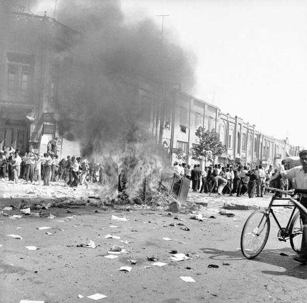 Recently declassified CIA documents reveal that the U.S. spy agency, as long suspected, was behind the Aug. 19, 1953, deposing of elected Iranian Prime Minister Mohammad Mosaddeq. Right-wing rioting, as shown in this file photo from Tehran on the day of Mossadeq's ouster, preceded the coup and the return of exiled Shah Mohammed Reza Pahlavi. Iranian legislators voted Tuesday to pursue a lawsuit against the United States for interference in Iranian domestic affairs.