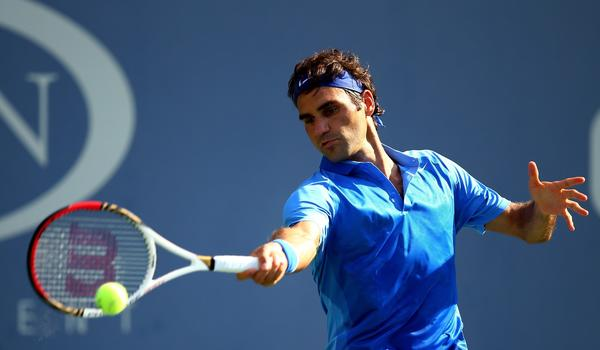 Roger Federer returns a shot during his first-round victory over Grega Zemlja at the U.S. Open on Tuesday.