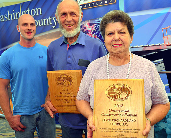 Michael Martz, left, and his father, Robert Martz, were recognized Tuesday for their work as sustaining conservation farmers, and Shirley Lewis received a plaque for outstanding conservation farmer.