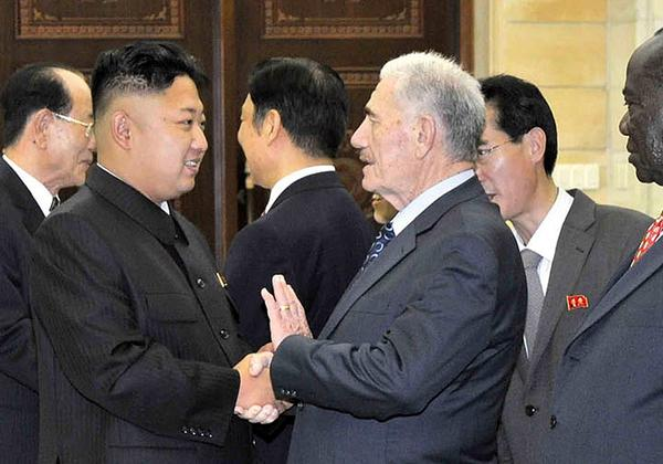 This undated photo released July 28 by North Korea's official news agency shows North Korean leader Kim Jong Un, left, welcoming Abdullah Ahmar, deputy general secretary of Syria's Baath Arab Socialist Party, in Pyongyang, the North Korean capital, for celebrations of the 60th anniversary of the armistice that ended fighting in the Korean War.