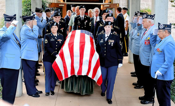 The casket carrying Heron Blevins is led out of Rest Haven Cemetery's chapel by Fort Belvoir's Combat Support Agency Support Command Tuesday afternoon.