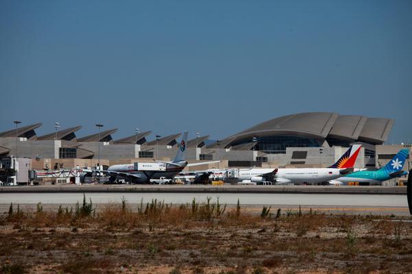Aircraft take off and land at LAX.