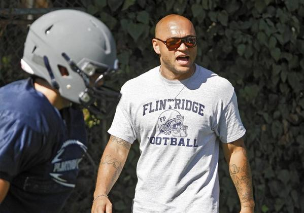 Flintridge Prep football Coach Antonio Harrison is determined to keep his program moving in the right direction in his fourth year. The Rebels won their first playoff game in nine years in 2012.