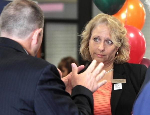 Orange teachers union president Diana Moore talks with an Orange County Public Schools official last year.