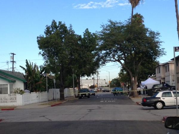 Police tape marks the area where two people were killed in a shooting in South Los Angeles.
