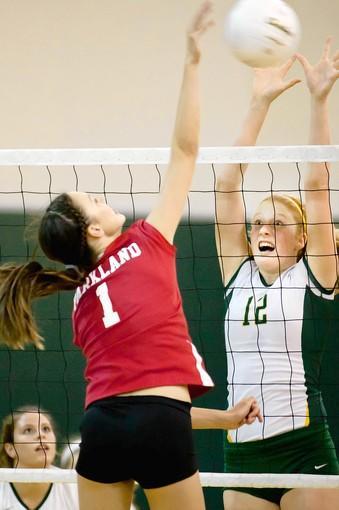Parkland's Brooke Robertson (1) spikes the ball past Emmaus' Corrine Justus (12) during their match at Emmaus High School on September 25, 2012.