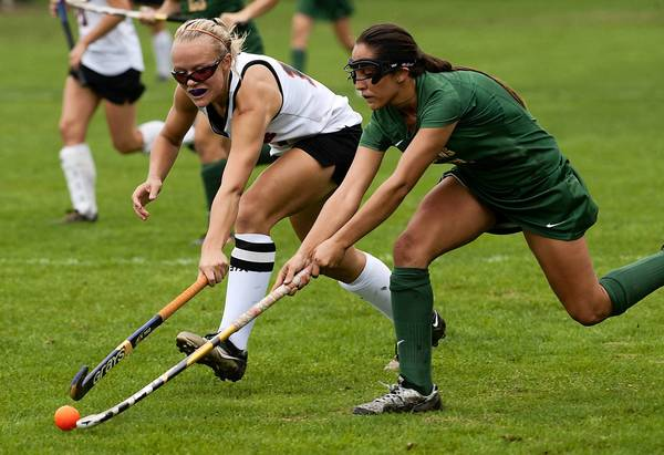 Northampton's (#14) Tori Gollie (left) battles Emmaus (#13) Krissy Mikelson during field hockey game at Northampton High School on October 3, 2012.