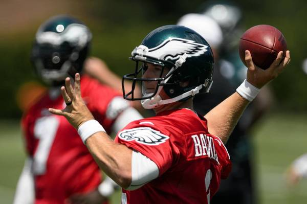 Jul 26, 2013; Philadelphia, PA, USA; Philadelphia Eagles fourth round draft pick quarterback Matt Barkley (2) passes the ball as quarterback Michael Vick (7) looks on during training camp at the Eagles NovaCare Complex.
