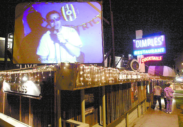 A 20-foot screen on the roof projects the live singers image for passersby on Olive Ave. in Burbank