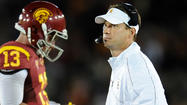 Football practice or target practice, USC's Lane Kiffin won't open up