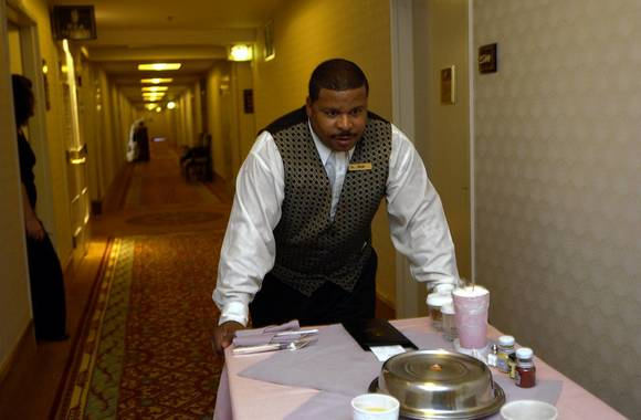 Derek Jackson a room service servant at the Hilton on Michigan Ave. prepares an order.