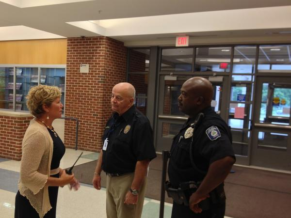 Glastonbury High School principal Nancy Bean goes over security with guard Glenn Catania and Glastonbury PD resource officer James Partee.