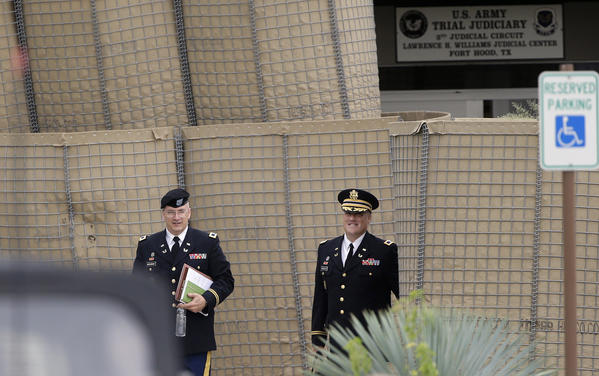 Prosecutors Col. Mike Mulligan, left, and Col. Steve Henricks leave the Lawrence William Judicial Center at Ft. Hood, Texas, after the second day of the sentencing phase in the trial for Maj. Nidal Hasan.