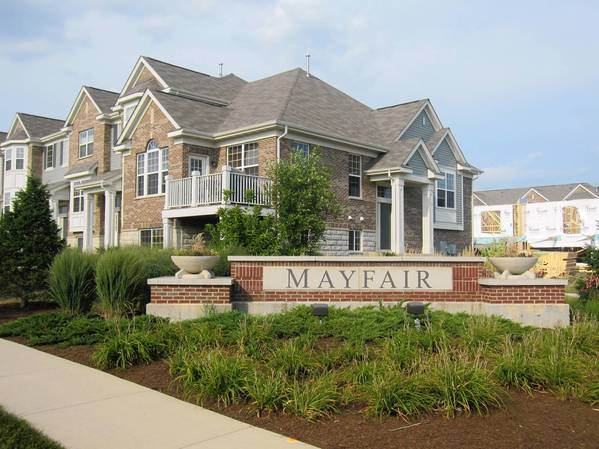 Naperville City Council has agreed to allow town houses on the commercial land east of Route 59 north of Audrey Avenue next to the first phase of the Mayfair town house development.