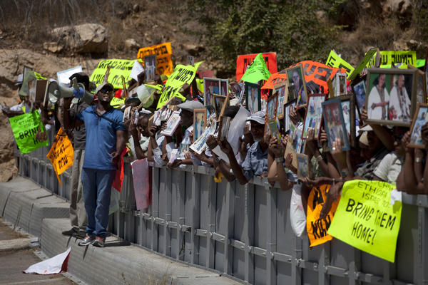 Ethiopian Israelis hold up photographs of their relatives during a demonstration outside Prime Minister Benjamin Netanyahu's office in Jerusalem on Wednesday.