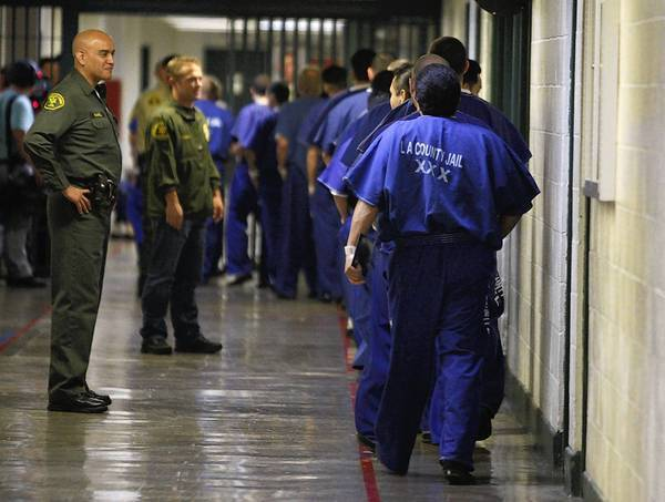 Sheriff's deputies watch inmates at the L.A. County Men's Central Jail. County jails would be one type of facility where some state prison inmates would be housed under Gov. Jerry Brown's proposal.