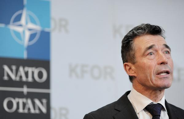 NATO Secretary-General Anders Fogh Rasmussen addresses journalists in Pristina, Kosovo, on July 3.