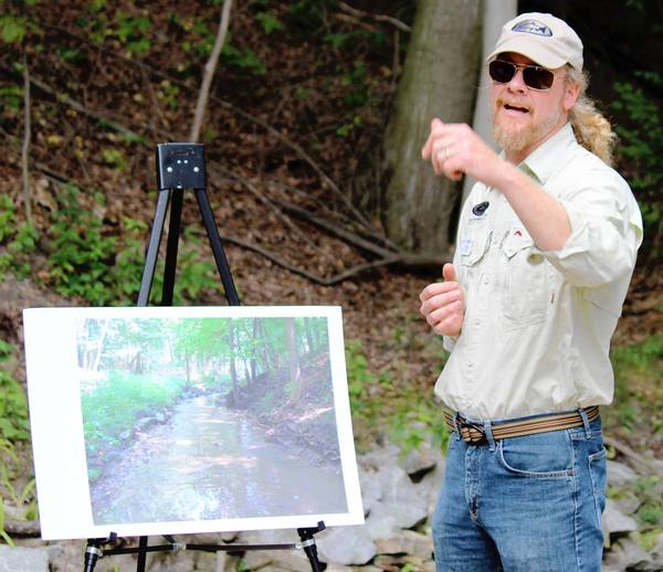 "Matt Jennings, of the Gary Borger Chapter of Trout Unlimited, explains the ravine ecosystem in a recent park district-led presentation on ""Ravine 7."""
