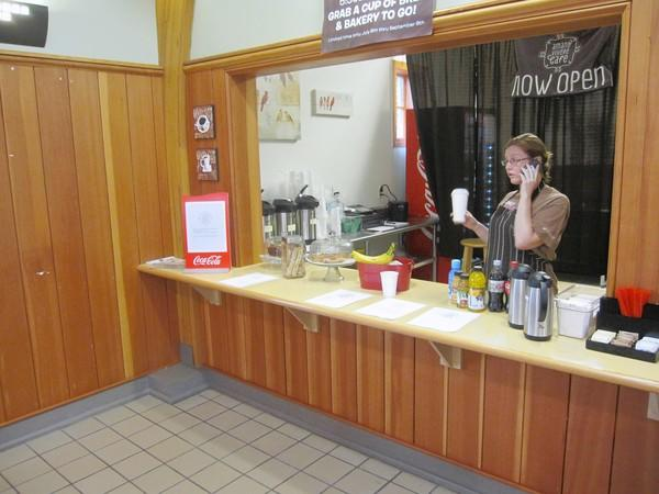 Rita Murphy sells coffee at the concession counter inside the 143rd Street Metra Station in Orland Park. The counter is operated by nearby Amano Vivere Café.