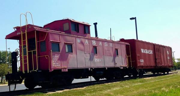 An antique caboose and boxcar are on display at the 153rd Street Metra station in Orland Park. Mayor Dan McLaughlin has asked train enthusiasts to attend a meeting Wednesday night to discuss further efforts to preserve the village's historical link to the railroad. Acquiring a steam engine for the 143rd Street Metra station is one idea.