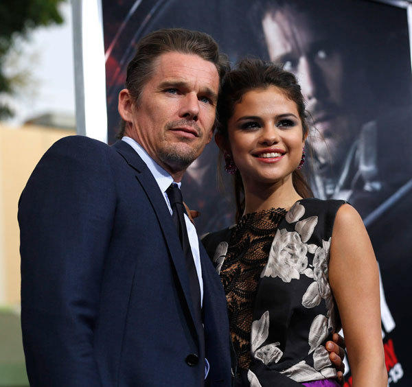 "Cast members Ethan Hawke (L) and Selena Gomez pose at the premiere of the film ""Getaway"" in Los Angeles, California."