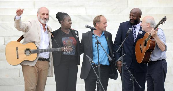"Singers Peter Yarrow and Paul Stookey during the ""Let Freedom Ring"" ceremony with Trayvon Martin's parents, Tracy Martin and Sybrina Fulton, and Mark Barden, father of Daniel Barden, one of the young victims of the Sandy Hook shooting."