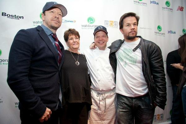 Donnie, Paul and Mark Wahlberg, along with their mother, Alma, at the opening of the original Wahlburgers in Hingham, Mass.