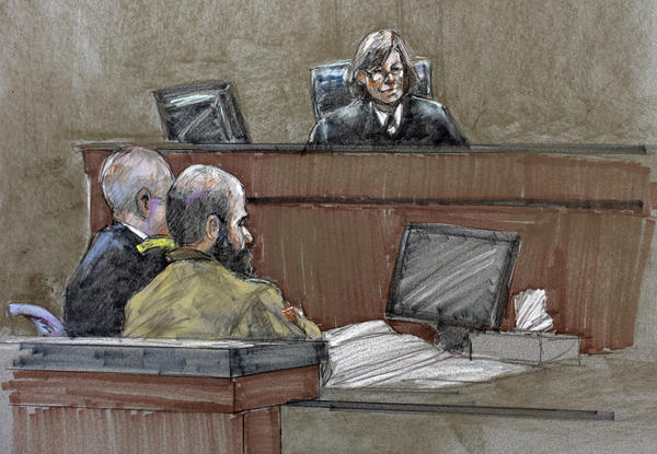 In this courtroom sketch, Maj. Nidal Hasan, center, sits before the judge, U.S. Army Col. Tara Osborn, during the sentencing phase of his trial at Ft. Hood, Texas.