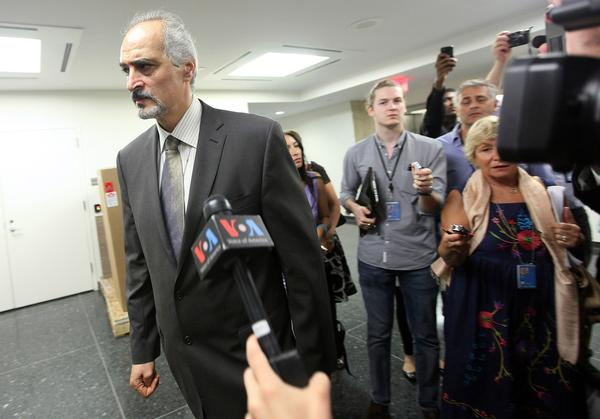 "Syrian ambassador to the United Nations Bashar Jaafari departs after speaking to reporters outside the U.N. Security Council in New York. ""We are in a state of war right now, preparing ourselves for the worst scenario,"" he said."
