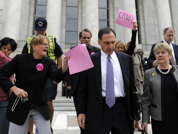 In this Oct. 6, 2008 file photo, Lehman Brothers Holdings Inc. Chief Executive Richard Fuld, front center, is heckled by protesters as he leaves Capitol Hill in Washington after testifying before a House committee on his company's collapse. A new study says he was among the country's best-paid CEOs for eight straight years -- until Lehman disintegrated.