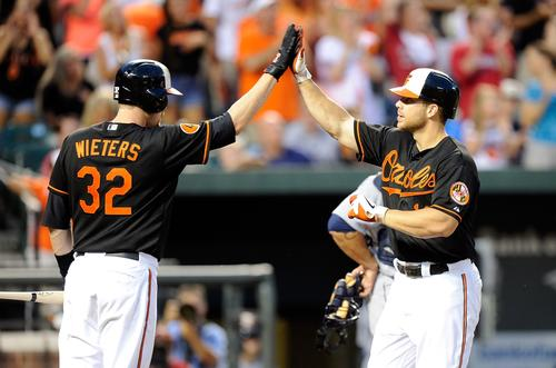 Chris Davis celebrates with Matt Wieters after hitting his 40th home run of the season.