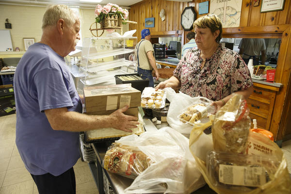 Enfield Loaves and Fishes president, Murray Brayson (right), and director, Priscilla Brayson (right), work with volunteers to help prepare the days meals.