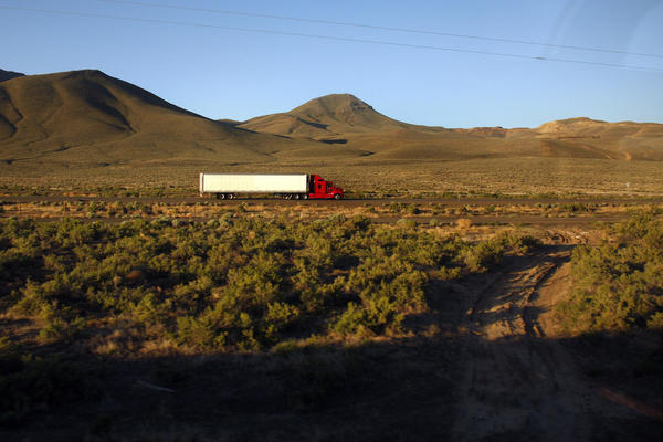 A truck is seen from the window of the 5 California Zephyr Amtrak train as it drives along Interstate 80 in Nevada in 2008.
