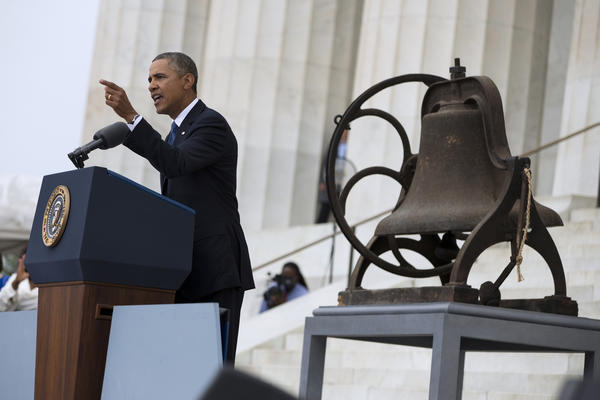 President Obama speaks at a ceremony commemorating the 50th anniversary of the March on Washington. Near him is a bell that once rang at the 16th Street Baptist Church in Birmingham, Ala., which was bombed days after the March On Washington, killing four young girls.