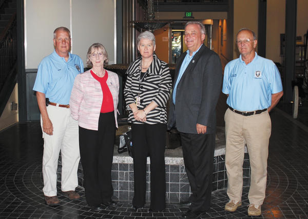 Anne Sheridan, third from left, executive director of the Governor's Office for Children, visited Washington County Monday. She is shown with, from left, County Commissioner John Barr, County Commissioner Ruth Anne Callaham, County Commissioner Jeff Cline and County Commissioner William McKinley.