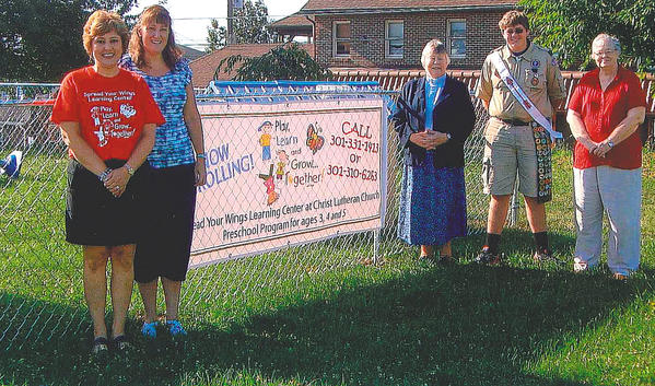 Boy Scout Nick Brandenburg completed his Eagle Scout project by putting a fence around the playground at Christ Lutheran Church on Cleveland Avenue in Hagerstown. From left, Jackie Kenworthy and Terri Gwizdala, Spread Your Wings Learning Center directors; Pastor Stephanie Steele, Brandenburg and Carol Gregg, church council president.