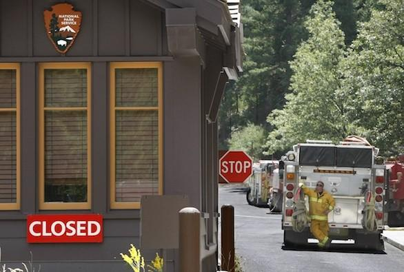 The western entrance to Yosemite National Park at Big Oak Flat remained shut Wednesday. Park officials also closed a portion of the park's major artery, Tioga Road, to aid fire suppression efforts.