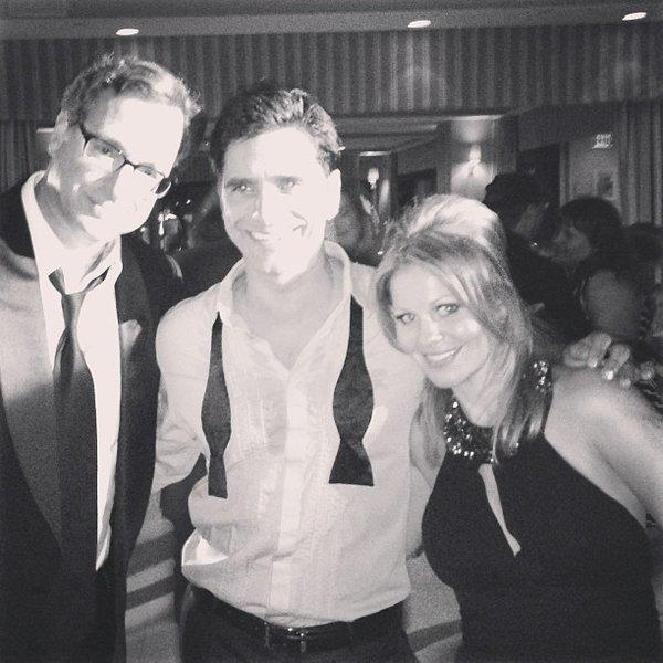 """Family Forever,"" Candace Cameron Bure captioned a photo from John Stamos' 50th birthday with the ""Full House"" crew. Bure, right, poses with Bob Saget, left, and Stamos at the party."