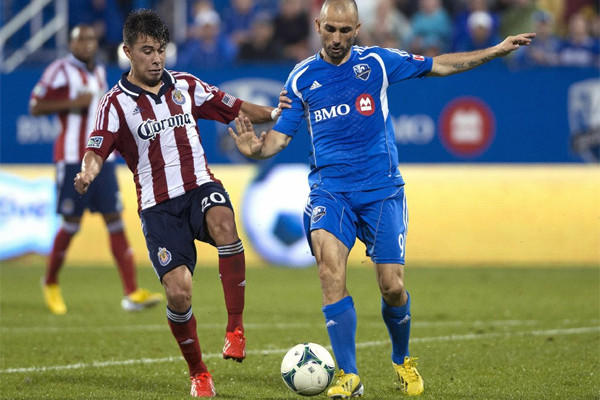 Chivas USA's Carlos Alvarez, left, challenges Montreal Impact's Marco Di Vaio for the ball during the second half of a match in July.