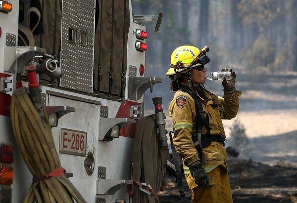 An El Dorado Hills firefighter takes a break from battling the Rim Fire Wednesday near Groveland.