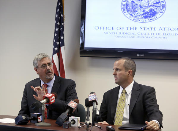 State Attorney Jeff Ashton, left, FDLE Special Agent in Charge Danny Banks speak to the media about the FDLE investigation of the textgate scandal on Wednesday, August 28, 2013.
