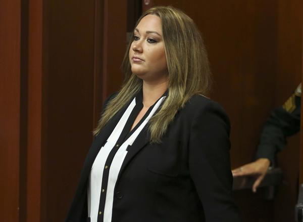 Shellie Zimmerman, the wife of George Zimmerman, pleads guilty to a lesser form of perjury at the Seminole County Courthouse in Sanford, on Wednesday, August 28, 2013.